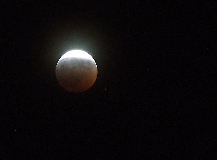 "Image of a partial lunar eclipse courtesy of Flickr's ""seeks2dream"" and"