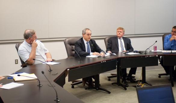 President Cabrera (center) addresses the Fairfax Campus Advisory Board, while Supervisor Cook (right) listens. (Photo Courtesy of Dakota Cunningham).