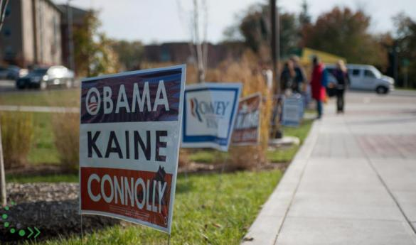 Campaign signs line the sidewalk in front of University Hall. (Photo by Dakota Cunningham).