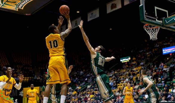 Sherrod Wright pulls up for a baseline jumper in win against William & Mary Saturday (Photo by Maurice Jones).