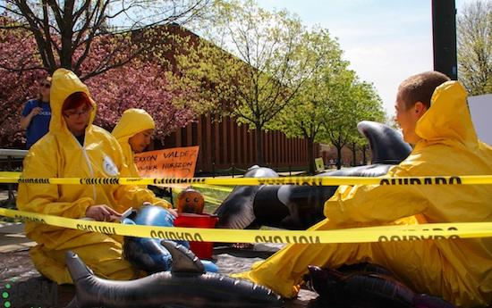 Students put on a mock oil spill to protest off-shore drilling (photo by John Irwin).