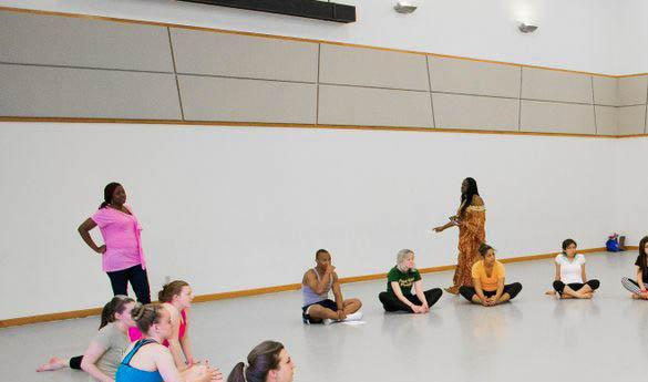 George Mason University African Dance instructor Kukuwa Nuamah circles up her students before the start of each class (photo by Gopi Raghu).