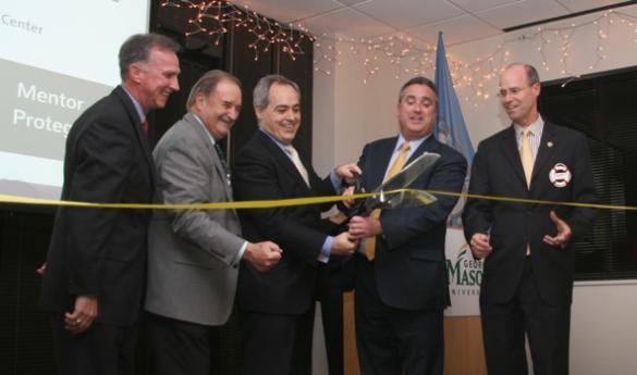 President Cabrera (third from left) joins Fairfax Mayor Silverthorne (fourth from left) in a ribbon-cutting ceremony following renovations to Fairfax's Mason Enterprise Center (photo courtesy of MediaForce PR).