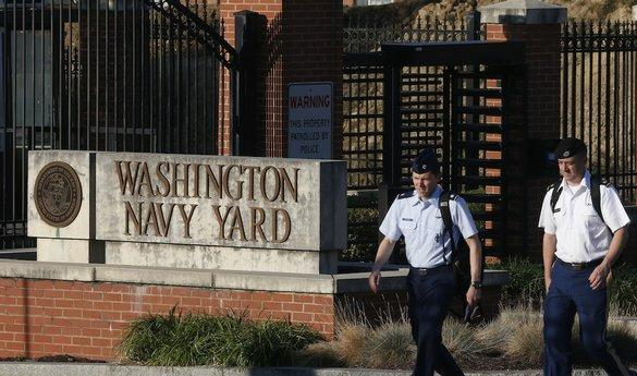 Two military personnel outside the entrance to the Washington Navy Yard (photo by AP photographer Charles Dharapak)